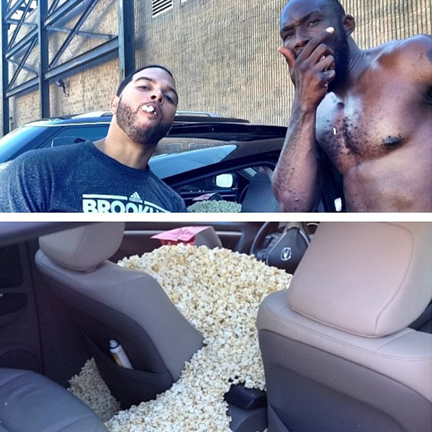 Deron Williams and Reggie Evans eat popcorn out of an Acura (Courtesy D-Will)