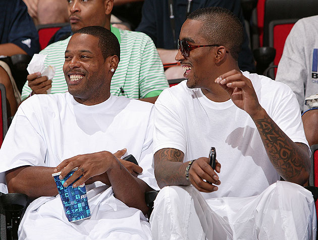 New Knicks teammates Marcus Camby (left) and J.R. Smith enjoy one another's company. (Getty Images)