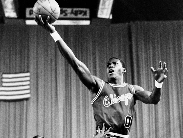 Orlando Woolridge swoops toward the basket against Detroit in 1984 (Getty Images)