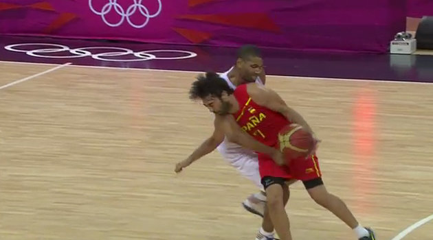 Nicolas Batum tries to stop the clock, amongst other things