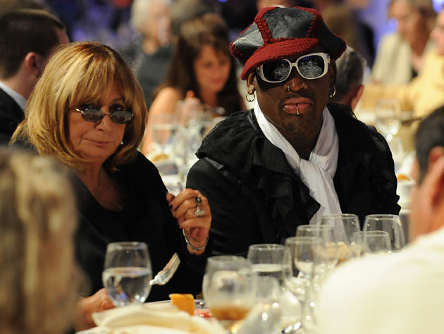 Penny Marshall and Dennis Rodman sit at the Algonquin Round Table of Mumbled Asides (Getty Images)
