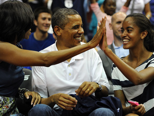 Michelle and Malia Obama celebrate as the president peels off another zinger (Getty Images)