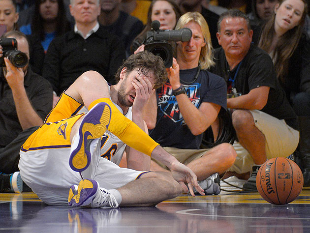 Pau Gasol goes down after being hit in the face by JaVale McGee on Jan. 6, 2013. (AP/Mark J. Terrill)