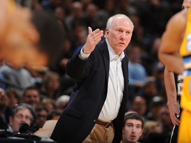 Gregg Popovich calls for the hack while JaVale McGee (obscured) gathers himself (Getty Images)