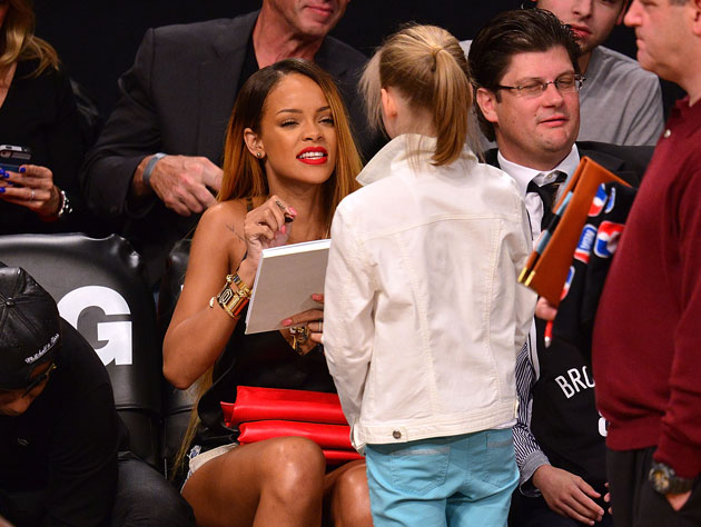 "Rihanna asks a young fan if she can smell ""something, I dunno, tangerine-y?"" (Getty Images)"