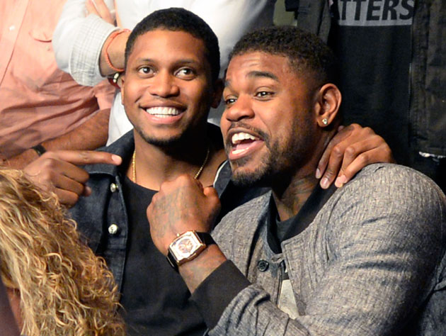 Rudy Gay and Amir Johnson take in the fights (Getty Images)