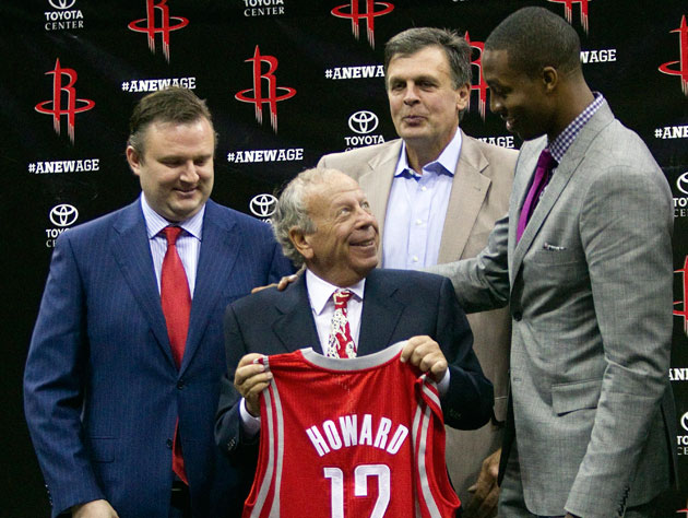 General manager Daryl Morey, owner Leslie Alexander, coach Kevin McHale and unidentified player (Getty Images)