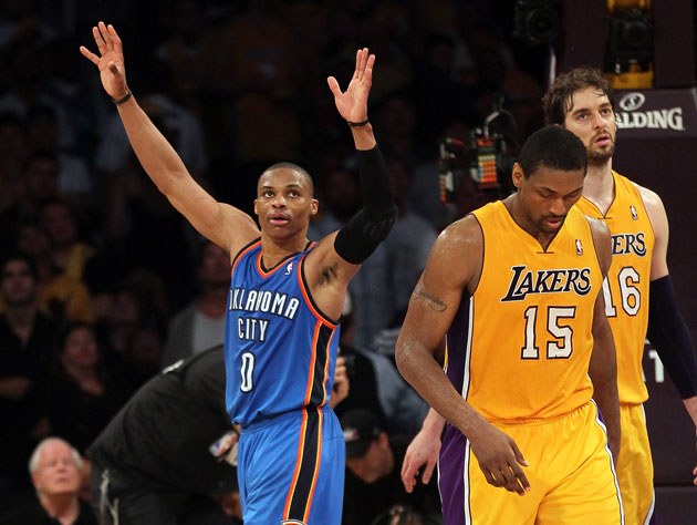 Russell Westbrook exults as Metta World Peace and Pau Gasol try to figure out what happened (Getty Images)