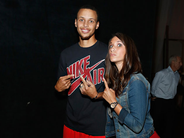 Stephen Curry and denim-clad admirer (Getty Images)