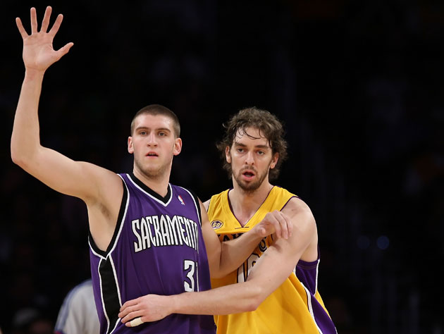 Spencer Hawes and Pau Gasol pass a very sweaty torch (Getty Images)