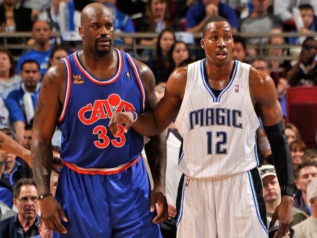 Dwight Howard lines up with Shaquille O'Neal in 2010 (Getty Images)