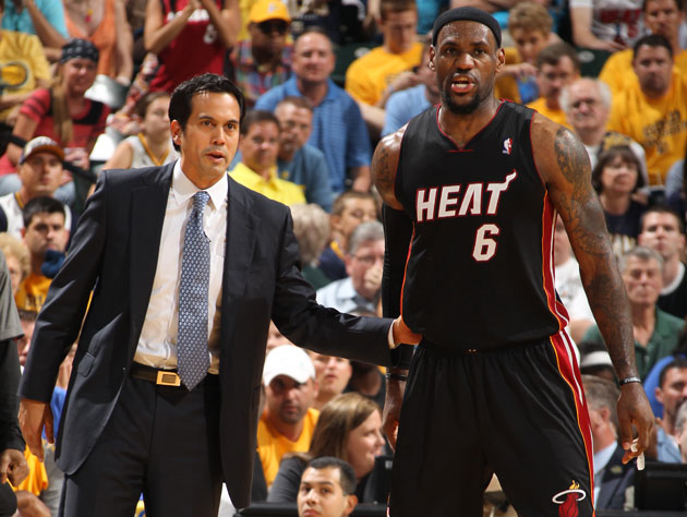 Erik Spoelstra gives LeBron James a little boost (Getty Images)
