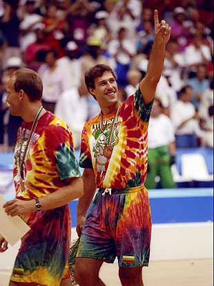 Sarunas Marciulionis, clad in Lithuania's famed tie-dye garb, celebrates. (Getty Images)