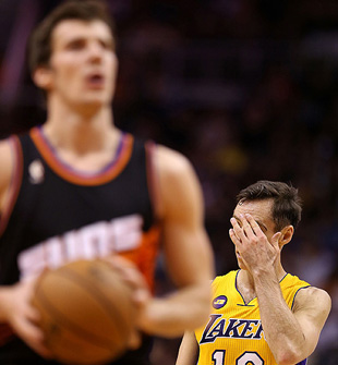Steve Nash's Just-Got-Beat-Off-The-Dribble Sense is tingling. (Christian Petersen/Getty Images)