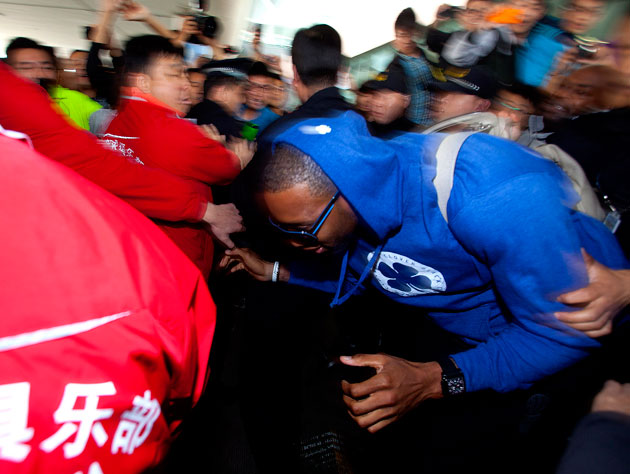 Hundreds of adoring fans greet Tracy McGrady's arrival in China last October (Getty Images)