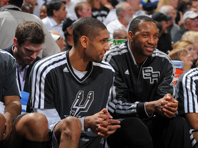 Tracy McGrady keep things pleasant on the San Antonio bench (Getty Images)