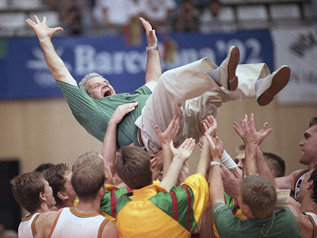The 1992 Lithuanian basketball team tosses coach Vladas Garastas in the air after winning bronze. (AP)