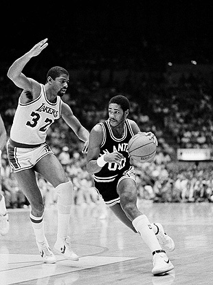 The Spurs' Johnny Moore drives on Magic Johnson of the Lakers in this May 1983 file photo. (AP)