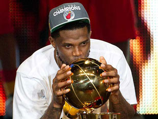 The ring's not here yet, so Udonis Haslem will kiss what he can. (AP)