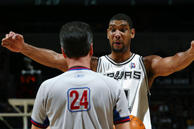 Tim Duncan tells referee Mike Callahan he can feel the burn. (Getty Images)