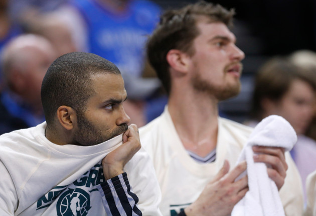 Tony Parker sits, stews and ponders. (AP/Sue Ogrocki)