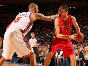 Tyson Chandler of the New York Knicks keeps Andrea Bargnani of the Toronto Raptors at arm's length. (Getty Images)