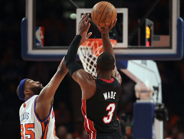 Dwyane Wade and Baron Davis, who hasn't jumped that high in five years (Getty Images)