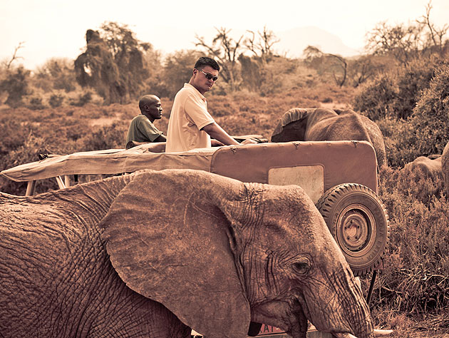 Yao Ming watches Kenyan elephants. (Photo by Kristian Schmidt for WildAid, via yaomingblog.com)