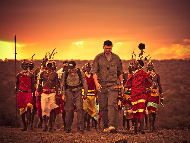 Yao walks with Samburu warriors in Kenya. (Photo by Kristian Schmidt for WildAid, via yaomingblog.com)