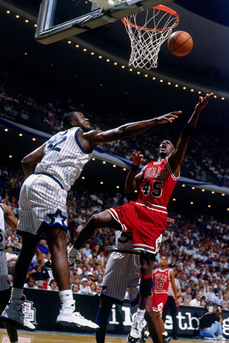 Shaquille O'Neal (really) tries to defend No. 45, Michael Jordan, in 1995. (Getty Images)