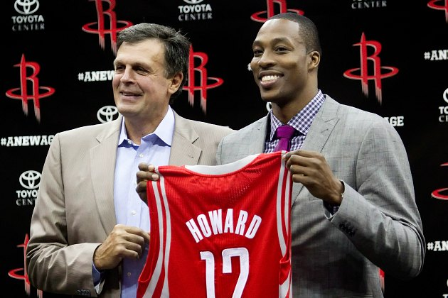Kevin McHale and Dwight Howard hold up a jersey not to be used for months (Bob Levey/ Getty).