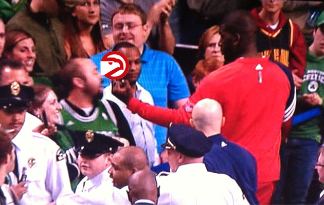 Ivan Johnson flips off a Boston Celtics fan following Atlanta's…