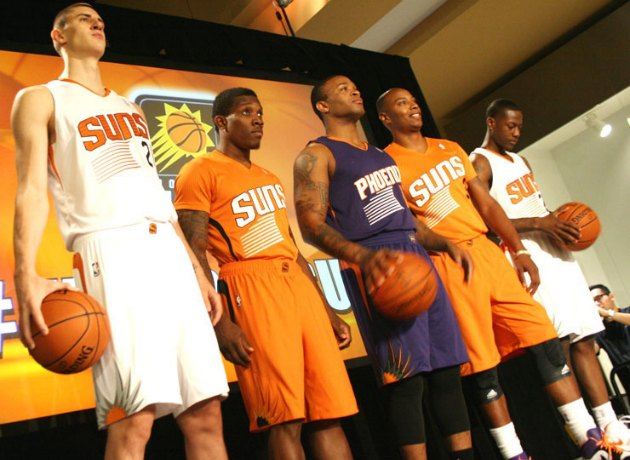 The Phoenix Suns show off their three new uniforms (Ryan Wolf/Suns.com).