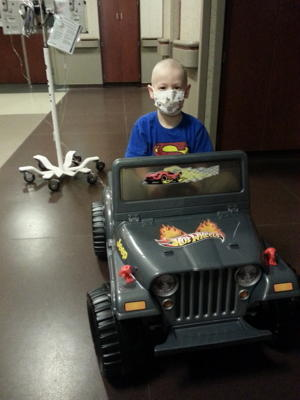 Avery drives a Hot Wheels jeep around Children's Hospital in Omaha (via Cheryl Harriman)