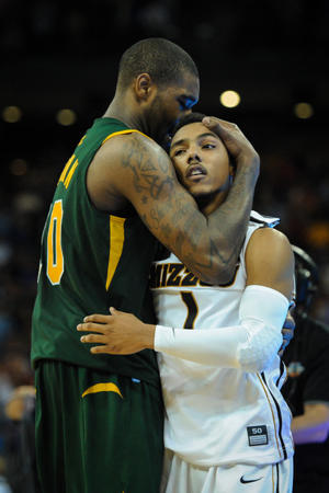 Kyle O'Quinn consoles Missouri's Phil Pressey after the game (Getty Images)