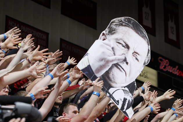 Cincinnati fans held up a cardboard cutout of Notre Dame football coach Brian Kelly on Monday (Getty Images)