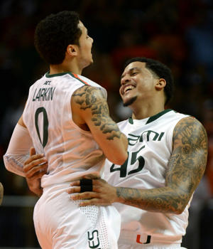 Julian Gamble and Shane Larkin celebrate Miami's win (Getty Images)