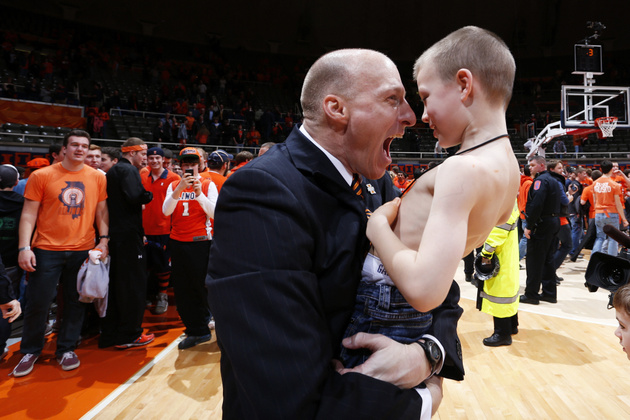 Illinois coach John Groce hugs his son Conner on Thursday night (Getty Images)