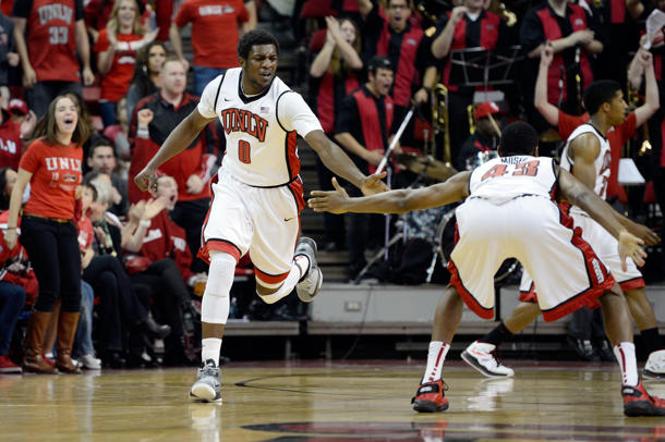 Savon Goodman (left) high-fives Mike Moser during a game last season (Getty Images)