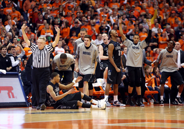 Georgetown's bench celebrates a basket by Otto Porter (Getty Images)