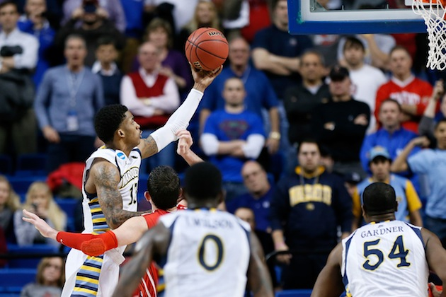 Marquette's Vander Blue scores the winning layup against Davidson on Thursday. (Getty Images)