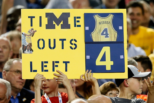 A boy in the crowd holds up a sign Saturday alluding to the infamous Chris Webber gaffe (Getty Images)