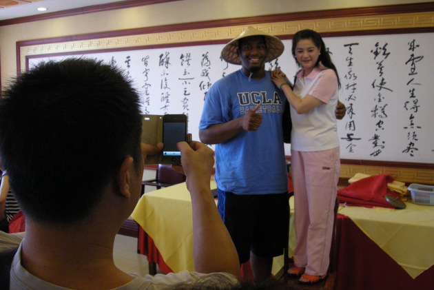 UCLA's Joshua Smith poses for a photo at the Guanjude Roast Duck Restaurant (via UCLA athletics)
