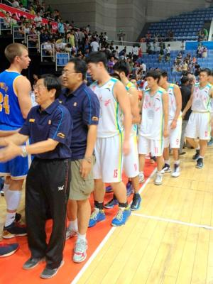 UCLA shakes hands with the opposition after its win (via @UCLAMBB)