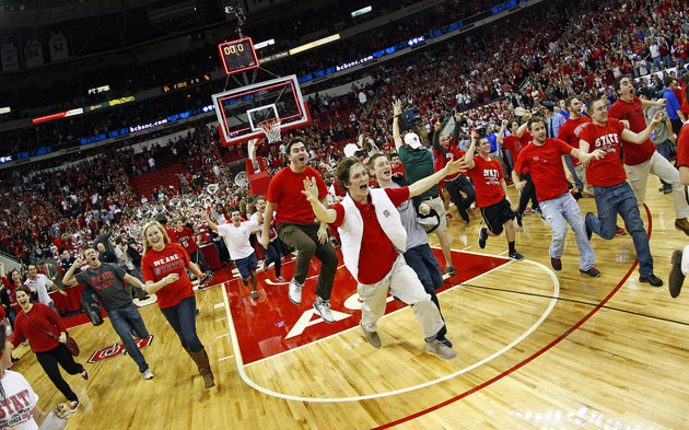 NC State fans rush the floor after 84-76 win over Duke (AP)