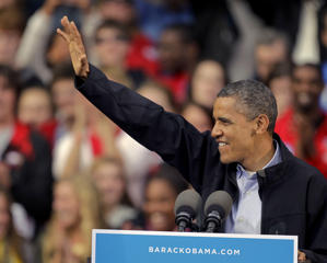 President Obama waves to the crowd in Madison on Thursday (AP)