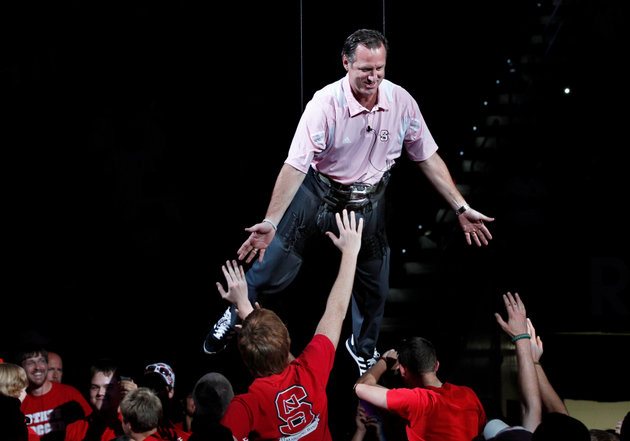 Mark Gottfried descends to the floor via harness at Primetime with the Pack (AP)