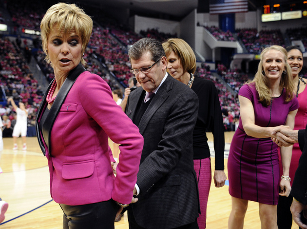 UConn coach Geno Auriemma and Baylor coach Kim Mulkey share an unusual pregame moment (AP)