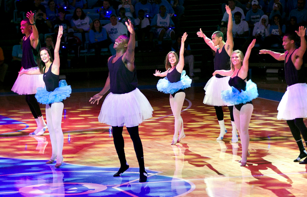 North Carolina freshman Joel James, center left, wears a tutu and shows off his dance moves (AP)