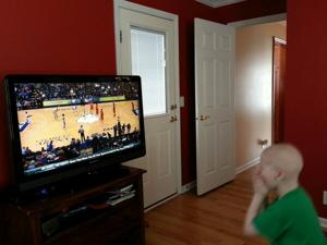 Avery nervously watches his dad's former team, Saint Louis, earlier this season (via @ChrisHarriman24)